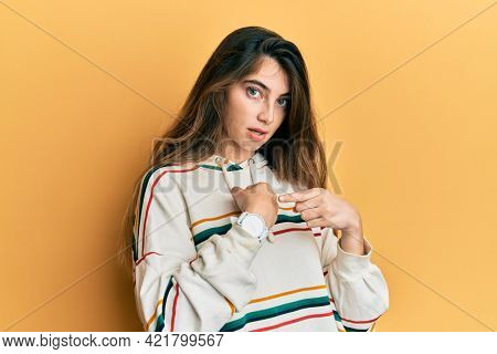 Young caucasian woman wearing casual clothes in hurry pointing to watch time, impatience, upset and angry for deadline delay