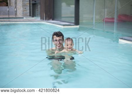 Dad Plays In The Pool With His Young Daughter, Summer Fun In The Water Park.