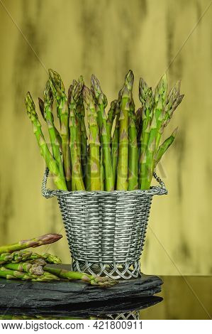 Green Fresh Asparagus. Bunches Of Green Asparagus In A Basket