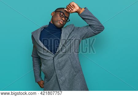 Young african american man wearing business clothes and glasses stretching back, tired and relaxed, sleepy and yawning for early morning
