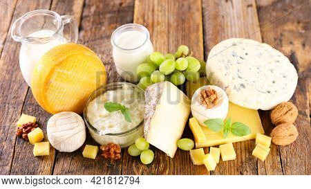 assorted of dairy products on wooden background