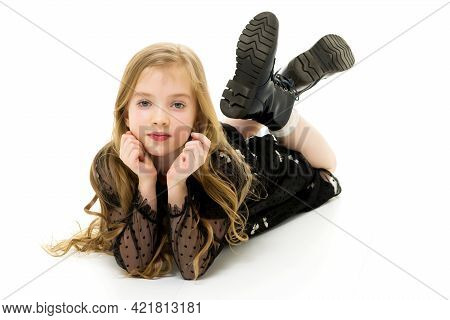 Little Girl Lies On The Floor.studio Photo Shoot On A White Back