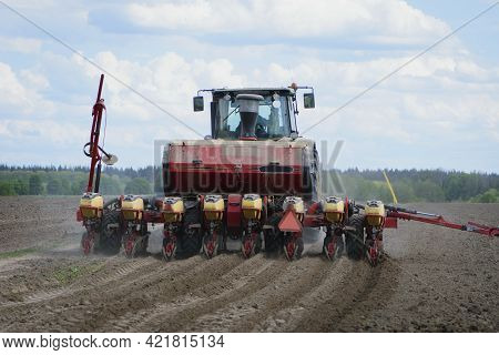 Red Tractor In A Field Rear View, Tractor Planting Crops On An Agricultural Field. Big Red Tractor W