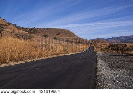 Rural Road Being Resurfaced With Dark Black Bitumen