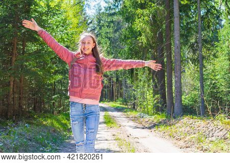 Young Traveler Girl Arms Outstretched Raised Enjoying The Fresh Air In The Green Summer Spring Fores
