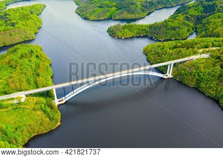 The Zdakovsky Bridge over Orlik reservoir is largest single-arch bridge in the world. Aerial view to famous monument in Czech republic, Central Europe.