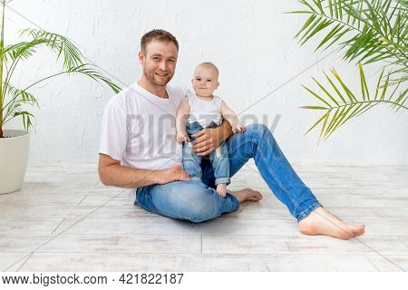 Dad With Baby Son In His Arms Hugging On A White Background, Happy Fatherhood, Father's Day