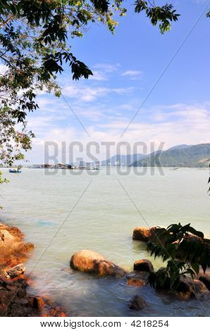 Beautiful Shore With View Of Mountains