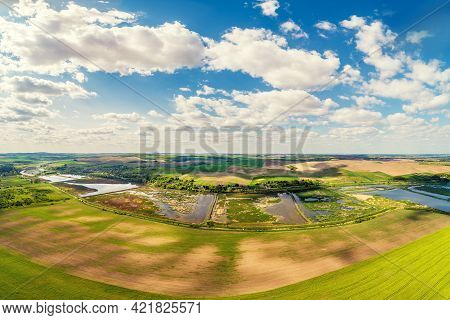 Aerial View Of Countryside, Arable Field And Brook On A Sunny Day In Summer. Beautiful Nature Landsc
