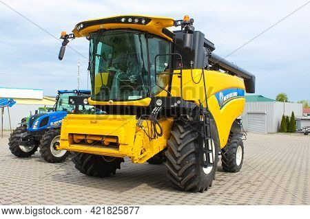 Kyiv, Ukraine - June 16, 2020: Yellow New Holland Combine Harvester Or New Holland Cx 6.90 Combine