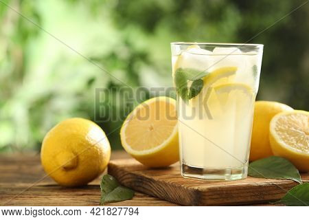 Cool Freshly Made Lemonade And Fruits On Wooden Table. Space For Text
