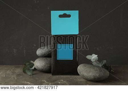 Scented Sachet, Spa Stones And Eucalyptus Branches On Grey Table