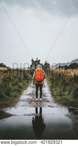 Rear view of a woman in front of Kilchurn Castle, Scotland mobile phone wallpaper