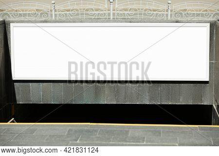 Blank Advertising Board Hanging On Wall Near Underground Passage