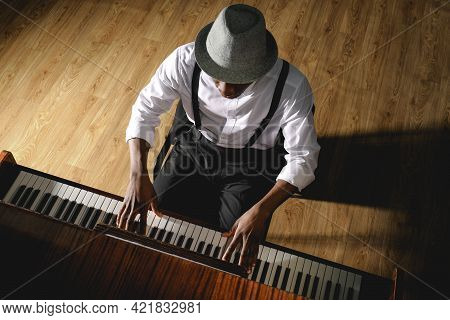African-american Man Playing Piano Indoors, Above View. Talented Musician
