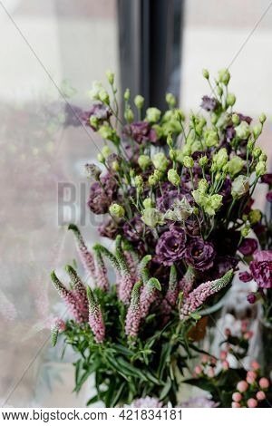 Lisianthus and pink heather in a flower shop