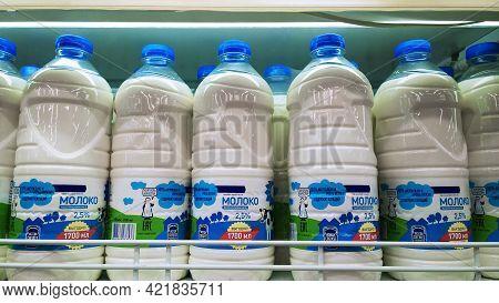 St. Petersburg, Russia - April 18, 2021: Pasteurized Milk In Plastic Bottles On Supermarket Shelves.