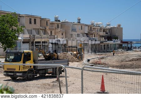 May 11, 2021 Cyprus, Paphos. Construction Work With Construction Equipment And Road Renovation Worke