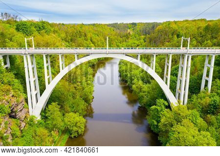 Bechyne Bridge or Bechyne Rainbow, rarely Rainbow Bridge is a unique reinforced concrete arch bridge over the river Luznice. Aerial view to monument in Czech Republic, Central Europe.