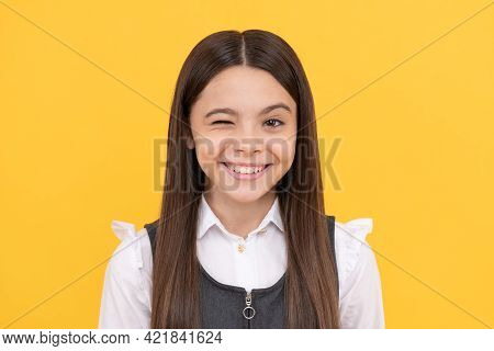 Happy School Age Girl Child With Smiling Face Give Wink Yellow Background, Winking