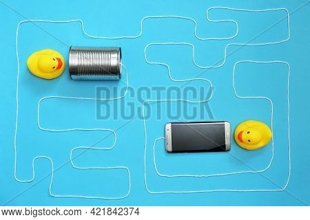 Communication Tin Can Phone With String And Smartphone And Toy Ducks