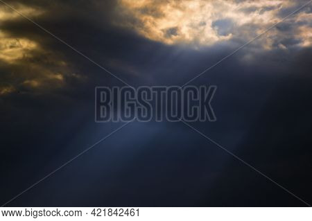Dramatic Sunset With Sunrays And Clouds In Summer