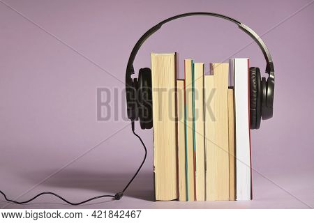 Audio Books Concept With Books And Headphones In Studio