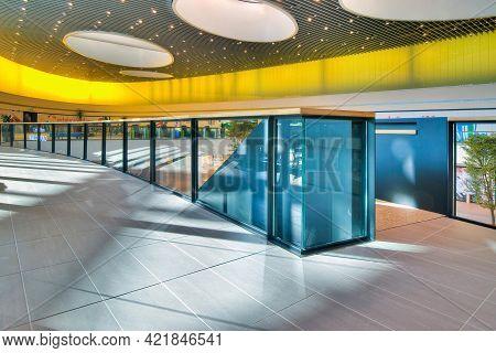 Krakow, Poland- July 19 2019: Empty Shopping Center In Bright Colors. Modern Shopping Centre Interio