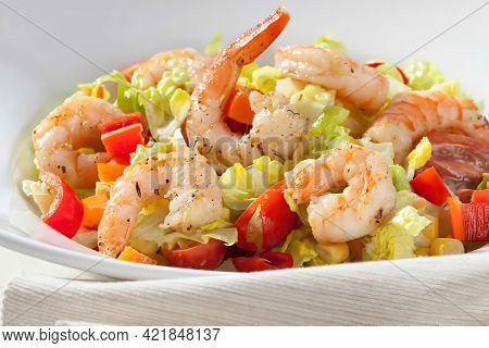 Bowl Of Scampis With Fresh Mixed Salad, Close Up