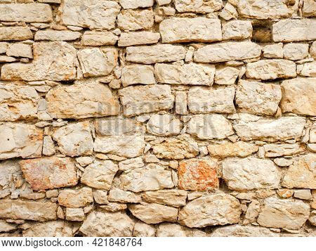 An image of an old sandstone wall