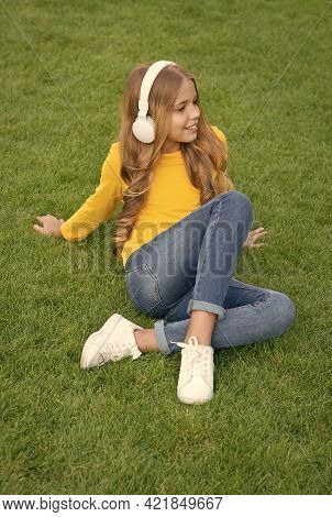Sounds Of Nature. Relax On Green Grass. Spring Leisure Time. Happy Childhood. Kid In Headset. Happy