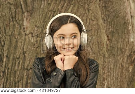 Only Music That Matters. Happy Girl Listen To Music Outdoors. Little Child Wear Headphones Playing M