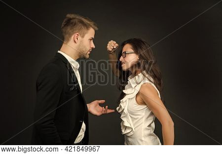 Angry Professional Woman Clench Fist At Male Coworker In Formalwear Dark Background, Fighting