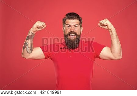 Always Stay Strong. Strong Hipster Flex Arms Red Background. Bearded Man Show Physical Strength. Bui