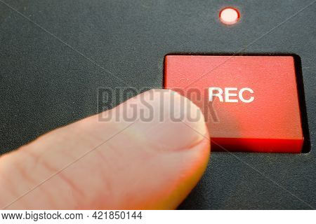 Record. A Finger Pushes Rec / Recording Button
