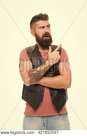 Guy Pointing With Index Finger. Hipster With Beard Brutal Guy. Product Recommendation Concept. Barbe