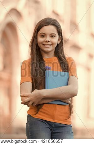 For Creative Learning. Happy Schoolgirl Outdoors. Little Schoolgirl Back To School. Small Schoolgirl