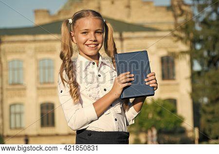Dig Into Good Book. Happy Bookworm Outdoors. Little Child Hold Book Outdoors. Library Book. Children