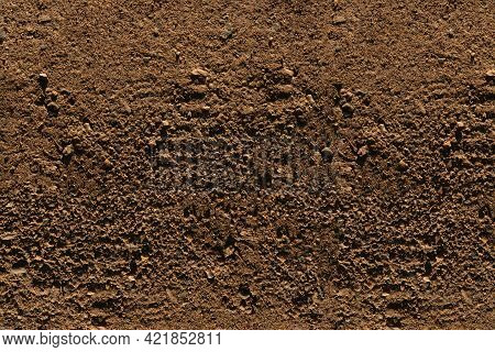 Ground Texture - Close-up Of A Fragment Of Brown Compact And Stony Ground - Stony Background