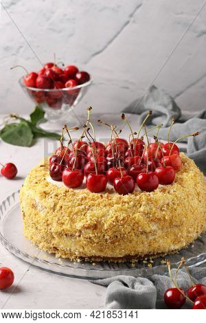 Homemade Festive Cake With Sweet Cherries On A Gray Background. Close-up. Top Of The Cake Is Decorat