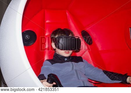 A Teenage Boy In 3d Reality Glasses Watches An Interesting Movie In The Illusion Of Complete Immersi