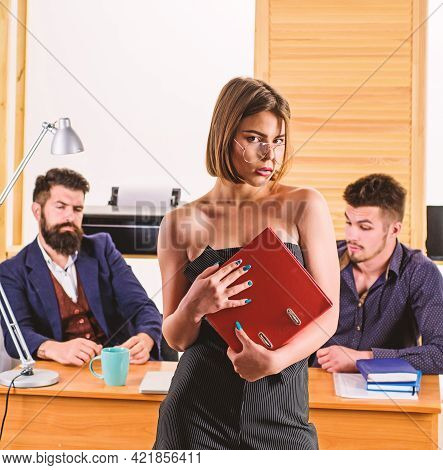 Sensual But Smart. Sensual Business Lady. Sensual Woman Standing In Front Of Businessmen In Office.