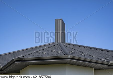 Grey Corrugated Metal Profile Roof Installed On A Modern House. The Roof Of Corrugated Sheet. Roofin