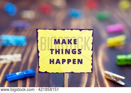 Make Things Happen - Phrase Motivation Concept, Colored Paper Plate, Wooden Background, Multicolored