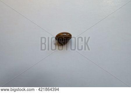 Glossy Brown Softgel Capsule Of Vitamin D3