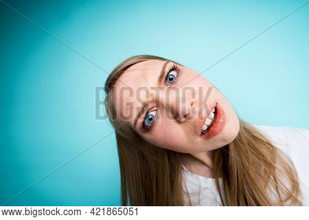 Close-up Photo, Fish Eye. The Girl Is Surprised And Opening Her Mouth Tilts Her Head To The Side Loo