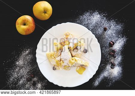 Authentic Recipe Of Austrian Torn Pancake Kaiserschmarrn With Raisins And Icing Sugar On Top And On