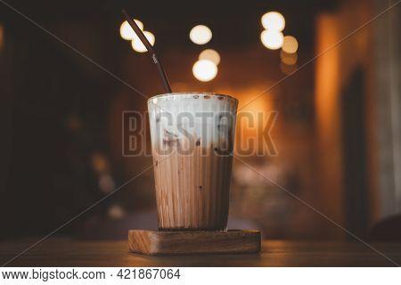 Iced Mocha With Milk Foam Against Bokeh Background