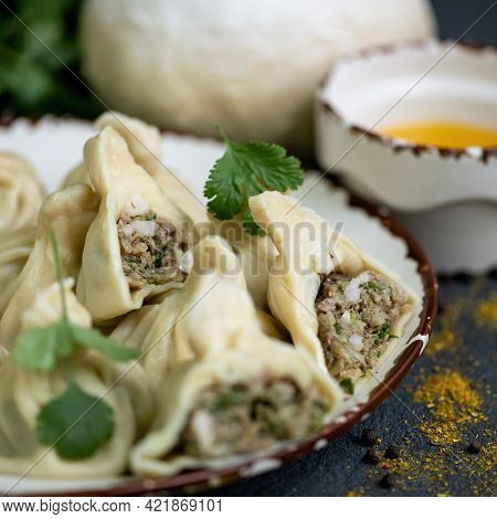 Cooked Dumplings Or Khinkali With Meat Filling. Close Up Shot Of A Delicious Nutritious Lunch Dish.