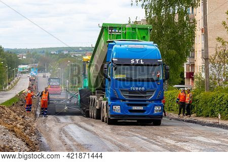 Ukraine, Khmelnytsky Region, Krasyliv. May 2021. Asphalt Paver On The Road During Asphalt Laying And